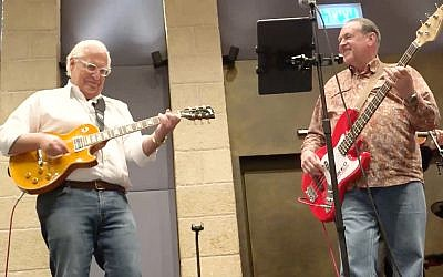 US ambassador David Friedman and former Arkansas governor Mike Huckabee play Lynyrd Skynyrd in Jerusalem, February 12, 2019. (Facebook screenshot)