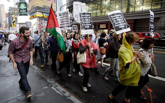 Palestinian and left-wing Jewish groups stage a rally walking from Times Square to the United Nations Building in New York, September 15, 2011, calling to end all US aid to Israel and support the Boycott, Divestment and Sanctions (BDS) movement against Israel. (AP Photo/David Karp)