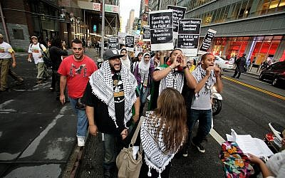 Palestinian and left-wing Jewish groups stage a rally walking from Times Square to United Nations Building in New York Thursday, Sept. 15, 2011. The marchers are calling to end all US aid to Israel, end the Occupation and support Boycott, Divestment, Sanctions (BDS) against Israel (AP Photo/David Karp)