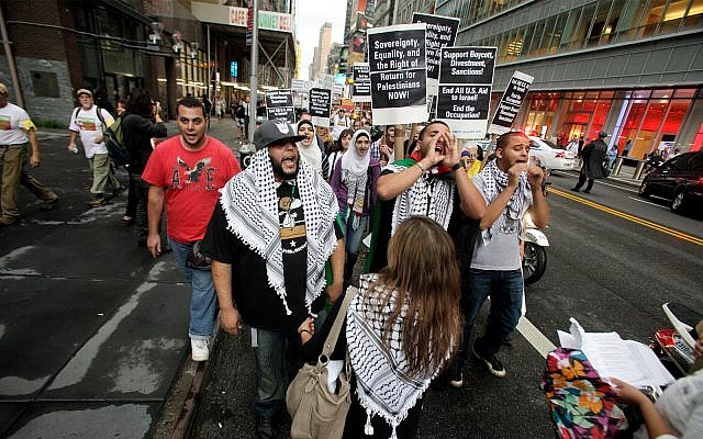 Illustrative: Palestinian and left-wing Jewish groups stage a rally walking from Times Square to United Nations Building in New York Thursday, Sept. 15, 2011. The marchers are calling to end all US aid to Israel, end the Occupation and support Boycott, Divestment, Sanctions (BDS) against Israel (AP Photo/David Karp)