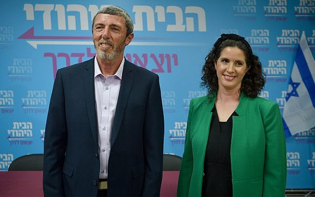 Head of the Jewish Home Party Rabbi Rafi Peretz with new party member Yifat Erlich in Tel Aviv, February 13, 2019. (Flash90)