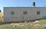 A home in the central West Bank Palestinian village of Beitillu, which was targeted in a price-tag attack on December 22, 2015. (Screen capture/Walla)