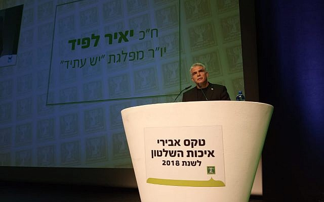 Yesh Atid chairman Yair Lapid speaks during an event hosted by the Movement for the Quality of Government, in Modi'in on February 4, 2019. (Movement for the Quality of Government)