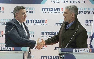 Labor chairman Avi Gabbay (L) welcoming former IDF Southern Command chief Tal Russo to the party, February 21, 2019. (Ra'anan Cohen)