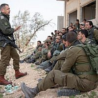 In a photo released by the Israel Defense Forces on February 26, 2019, Chief of Staff Aviv Kohavi (2nd-L) speaks with soldiers taking part in a snap drill at the Tzeelim base in southern Israel simulating a future military conflict in the Gaza Strip. (Israel Defense Forces)