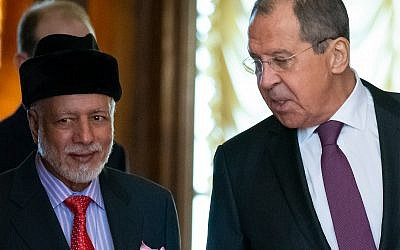 Russian Foreign Minister Sergey Lavrov, right, and Oman's Foreign Minister Yusuf bin Alawi bin Abdullah enter a hall for talks in Moscow, Russia, February 18, 2019. (AP Photo/ Alexander Zemlianichenko)