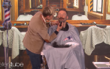 Ellen Degeneres (L) shaves the beard of Julian Edelman of the New England Patriots  for charity (Screencapture/YouTube)