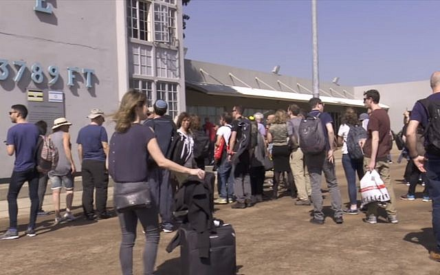 Israeli tourists visit the tower at Entebbe Airport where hostages were held captive in 1976, on February 14, 2019 (Screen grab via NTV)