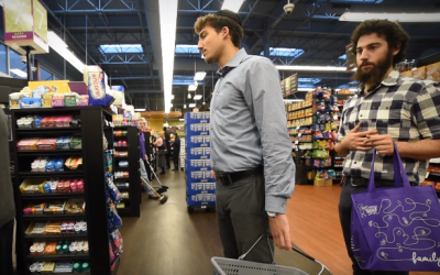 Shoppers at a 'Seasons' store (YouTube screenshot)