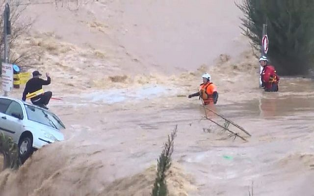 Man is rescued from floodwaters in the Arazim Valley, west of Jerusalem, February 28, 2019. (Channel 12 screen capture)