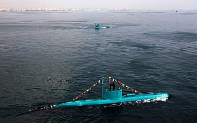 Iran's newly launched Ghadir submarines move in the southern port of Bandar Abbas in Persian Gulf, Iran, Wednesday, Nov. 28, 2012. Ghadir class submarines can fire missiles and torpedoes at the same time, and can operate in the Persian Gulf's shallow waters. (AP Photo/Fars News Agency, Ebrahim Norouzi)