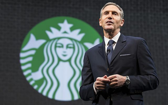 Then Starbucks Chairman and CEO Howard Schultz speaking at a Starbucks annual shareholders meeting in Seattle, March 18, 2015. (Stephen Brashear/Getty Images via JTA)