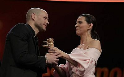 Filmmaker Nadav Lapid (left) accepting the Berlinale Golden Bear for his latest film, 'Synonyms' (Courtesy PR)