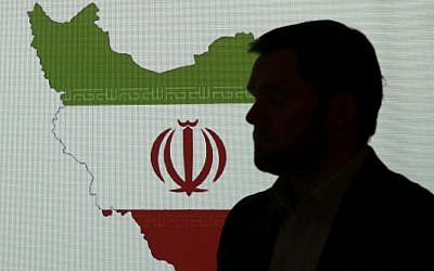 Illustrative: A cybersecurity expert stands in front of a map of Iran as he speaks to journalists about the techniques of Iranian hacking, September 20, 2017, in Dubai, United Arab Emirates. (AP/Kamran Jebreili)