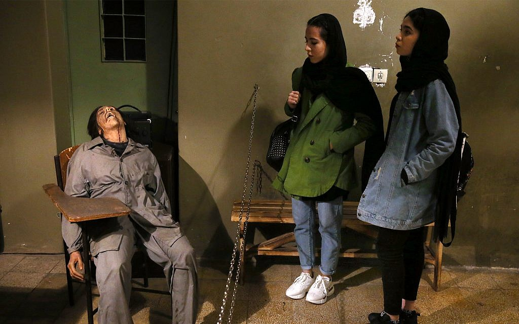 Women look at an exhibition at a former prison run by the pre-revolution intelligence service, SAVAK, now a museum, where a wax mannequin of a tortured female prisoner is on display, in downtown Tehran, Iran, January 7, 2019. (AP Photo/Ebrahim Noroozi)