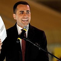 """Five-Star Movement candidate premier, Luigi Di Maio, speaks at his party's final rally in Rome, Friday, March 2, 2018. Di Maio met with """"yellow vest"""" anti-government protesters outside of Paris last week, igniting a diplomatic spat between the two countries. (AP Photo/Andrew Medichini)"""