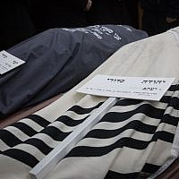 The covered bodies of Yehuda and Tamar Kaduri at their funeral in Jerusalem, January 14, 2019. (Noam Revkin Fenton/Flash90)