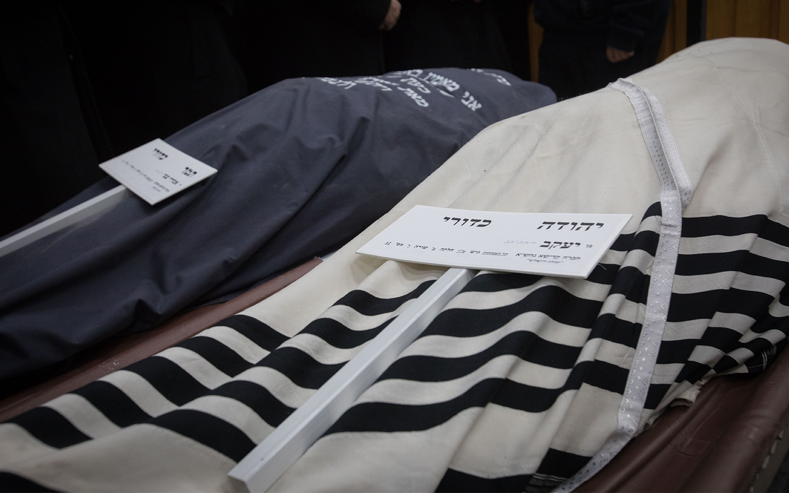 4eb7c6b5b47 The covered bodies of Yehuda and Tamar Kaduri at their funeral in  Jerusalem, January 14, 2019. (Noam Revkin Fenton/Flash90)
