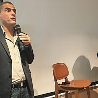 Mossi Raz speaking to an audience in Tel Aviv on February 21, 2019; at right is Times of Israel's Miriam Herschlag.  (Simona Weinglass/Times of Israel)