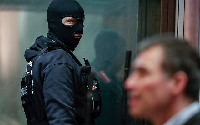 A policeman checks the accused box prior the start of the trial of Mehdi Nemmouche at the Justice Palace in Brussels, February 7, 2019. (Stephanie Lecocq, Pool Photo via AP)