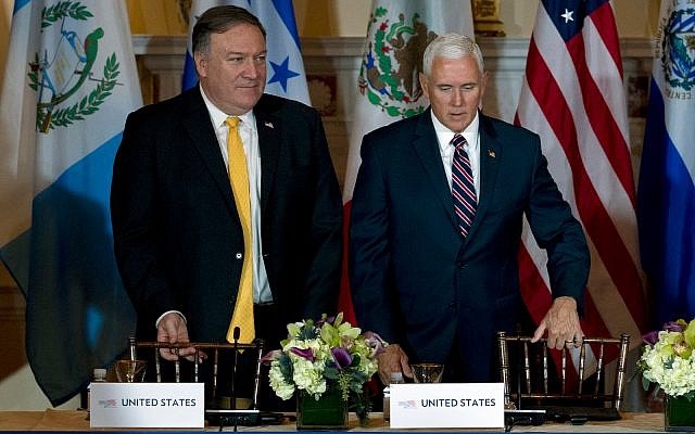 US Vice President Mike Pence, right, and US Secretary of State Mike Pompeo arrive at the second Conference for Prosperity and Security in Central America at the State Department on October 11, 2018, in Washington. (AP Photo/Jose Luis Magana)