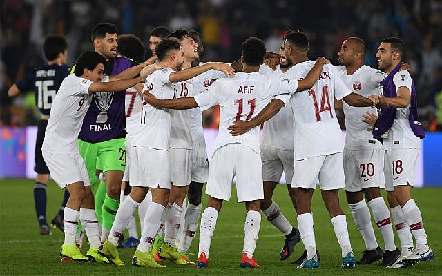 Qatari players run to celebrate after winning the AFC Asian Cup final match between Japan and Qatar in Zayed Sport City in Abu Dhabi, United Arab Emirates, Friday, Feb. 1, 2019. (AP Photo/Hassan Ammar)