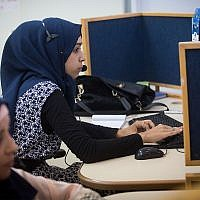 Israeli Bedouin women working at a Bezeq customer service center, located in a mosque, in the southern Arab town of Hura, July 27, 2015. (Miriam Alster/FLASH90)