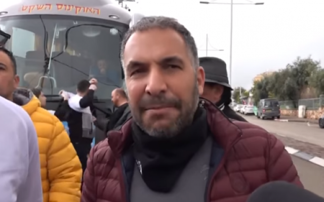 Tiberias mayor Ron Kobi speaks in front of the new line of Saturday public transportation in the northern city on February 9, 2019. (Screen capture/YouTube)
