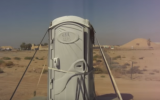 Illustrative: A portable toilet in the desert (YouTube screenshot)