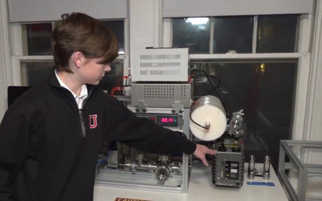 Jackson Oswalt shows his homemade fusion reactor to Fox News. (Fox News screenshot)