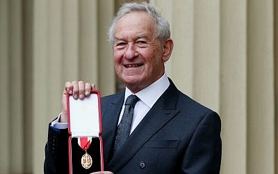 Historian Simon Schama poses after being awarded a knighthood in an investiture ceremony at Buckingham Palace in London, February 5, 2019. (Jonathan Brady/WPA Pool/Getty Images via JTA)