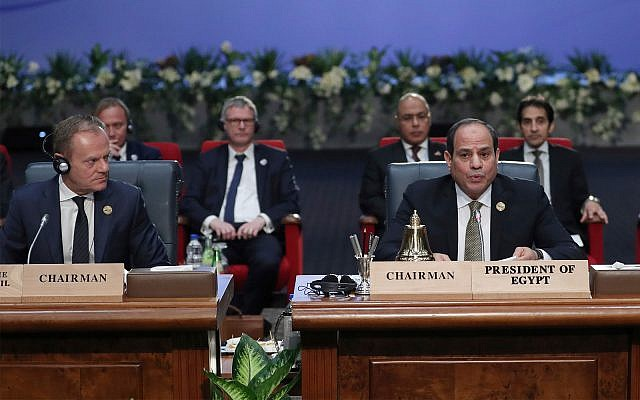 European Council President Donald Tusk, left, and Egypt's President Abdel-Fattah el-Sisi, right, attend a round table meeting at an EU-Arab summit at the Sharm El Sheikh convention center in Sharm El Sheikh, Egypt, February 24, 2019. (AP Photo/Francisco Seco)
