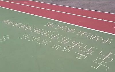 Illustrative: Swastikas found drawn on an elementary school playground in Queens, New York, February 22, 2019. (YouTube screenshot)