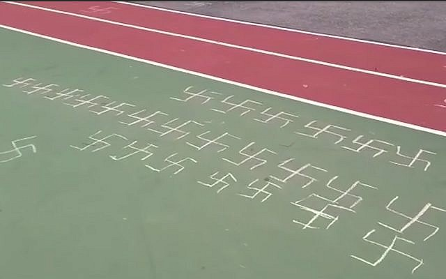 Swastikas found drawn on an elementary school playground in Queens, New York, February 22, 2019. (YouTube screenshot)