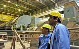 In this photo released by China's Xinhua News Agency, staff work in the turbine building of the Bushehr nuclear power plant near the southern Iranian port city of Bushehr, February 25, 2009. (AP Photo/Xinhua, Liang Youchang)