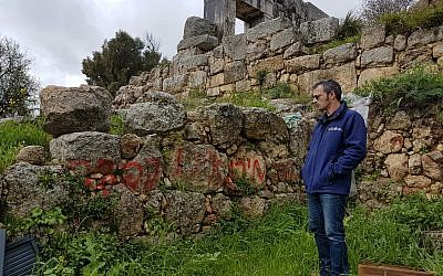 Uri Berger, an archaeologist in the Upper Eastern Galilee, filed a complaint with the police for the vandalism at the Mt. Meron Nature Reserve on March 4, 2019. (Nadia Azar/Israel Antiquities Authority)