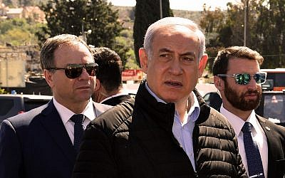 Prime Minister Benjamin Netanyahu visiting the site of a terror attack at Ariel Junction in the northern West Bank, March 18, 2019. (Ariel Hermoni/Defense Ministry)