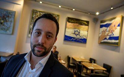 Israeli restaurateur Yorai Feinberg poses during an interview on February 26, 2019, at his restaurant in Berlin. (John MacDougall/AFP)