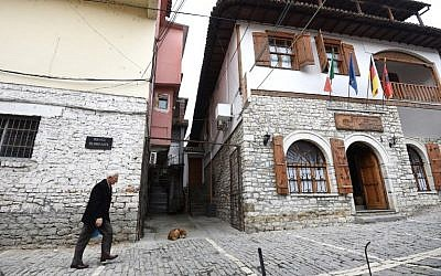 A man walks through Hebrew Street in the Albanian city of Berat on February 6, 2019. (Gent Shkullaku/AFP)