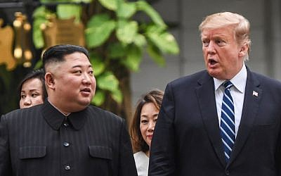 US President Donald Trump (R) walks with North Korea's leader Kim Jong Un during a break in talks at the second US-North Korea summit at the Sofitel Legend Metropole hotel in Hanoi, Vietnam, on February 28, 2019. (Saul Loeb/AFP)