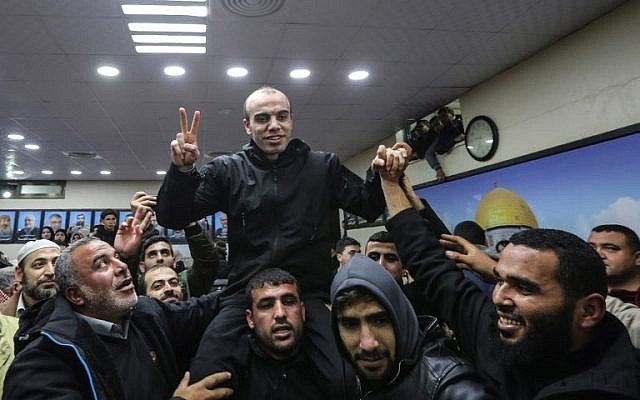A Hamas member released by Egyptian authorities is greeted by supporters before meeting the terror group's leader Ismail Haniyeh in the Gaza Strip on February 28, 2019. (MAHMUD HAMS/AFP)