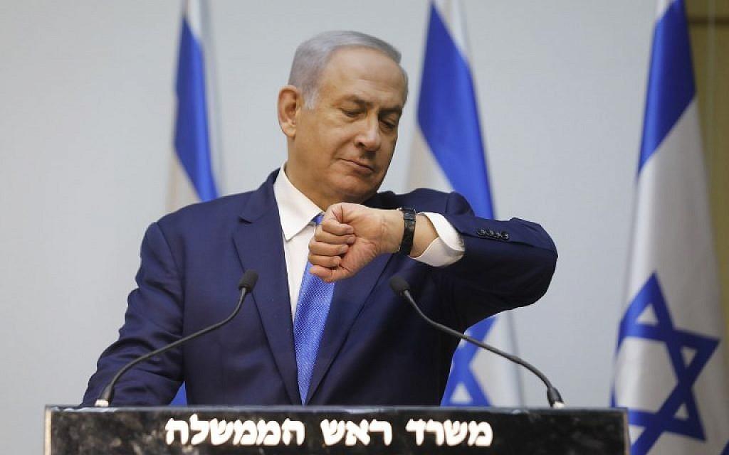 Prime Minister Benjamin Netanyahu prepares to deliver a statement at the Knesset, December 9, 2018. (MENAHEM KAHANA / AFP)