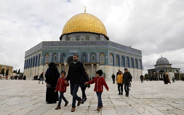 Palestinian Muslim worshipers walk past the Dome of the Rock mosque, situated in the al-Aqsa compound on the Temple Mount in Jerusalem's Old City, March 1, 2019, before Friday noon prayers. (Ahmad Gharabli/AFP)