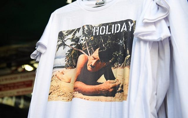 This photo taken on February 27, 2019, shows a t-shirt with a picture depicting a nude Adolf Hitler on a beach for sale at a street market for tourists in Bangkok. (Lillian SUWANRUMPHA / AFP)