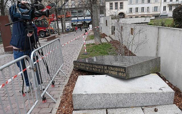 A cameraman films the memorial stone marking the site of Strasbourg's Old Synagogue, which was destroyed by the Nazis in World War II, after it was vandalized overnight on March 2, 2019 in Strasbourg, France. (Frederick Florin/AFP)