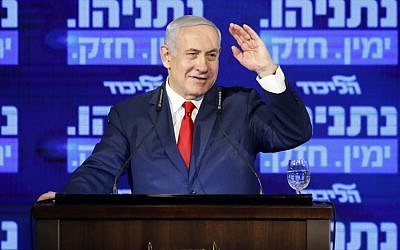 Prime Minister Benjamin Netanyahu waves, as he delivers a speech during the launch of his election campaign at the headquarters of his party Likud, for the upcoming April elections, in Ramat Gan on March 4, 2019. (Jack GUEZ / AFP)