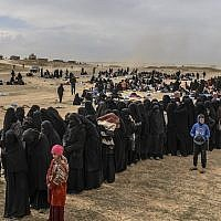 Civilians evacuated from the Islamic State group's embattled holdout of Baghouz wait at a screening area held by the US-backed Kurdish-led Syrian Democratic Forces (SDF), in the eastern Syrian province of Deir Ezzor, on March 5, 2019 (Bulent KILIC / AFP)