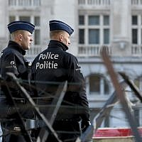 Policemen stand in front of the courthouse in Brussels on March 7, 2019, as the verdict is expected in the trial of the alleged Brussels Jewish museum attacker Mehdi Nemmouche. (John Thys/AFP)