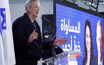 "Retired Israeli army general Benny Gantz, one of the leaders of the Blue and White political alliance, speaks next to a large screen depicting his face next to a caption in Arabic reading ""equality is a red line,"" as he addresses members of the Druze community of Israel in the city of Daliyat al-Karmel in northern Israel on March 7, 2019. (Photo by JACK GUEZ / AFP)"