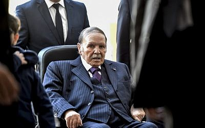 Algerian President Abdelaziz Bouteflika seen voting at a polling station in the capital Algiers during polls for local elections in 2017. (Photo by RYAD KRAMDI / AFP)